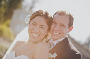 close up of smiling bride and groom
