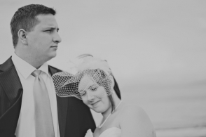 groom and bride with birdcage veil