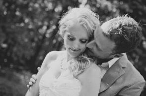 bride and groom embrace black and white