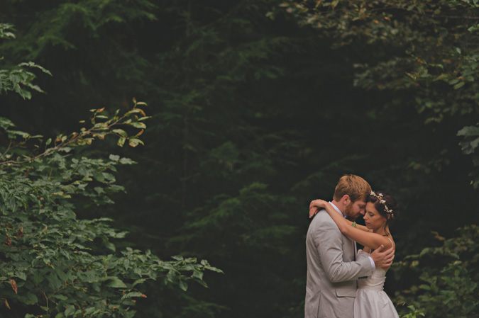 bride & groom embracing on their wedding day, strathcona park lodge, vancouver island, bc