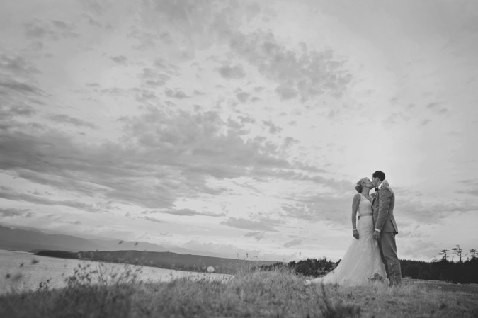 dramatic portrait of a bride & groom on the cliffs of helliwell park, hornby island, bc