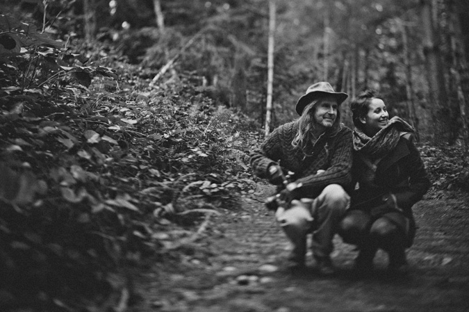 a couple laughing in the forest, helliwell park, hornby island, bc