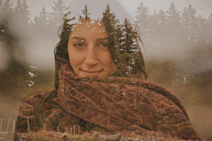 double exposure of a woman & the forest