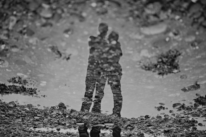 reflection of a couple in a tidal pool on the beach, cape lazo, comox, bc