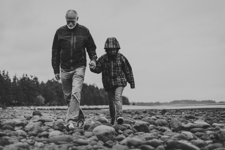 family travels - campbell river-father & daughter walking on the beach-multi-racial family
