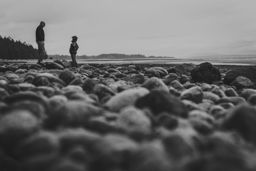 family travels - campbell river-father & daughter on beach-multi-racial family