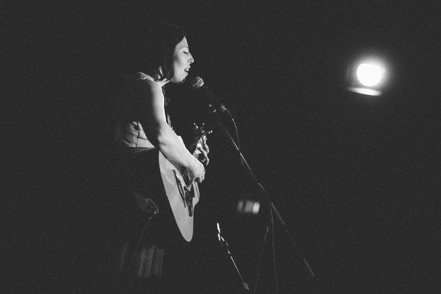 female singer songwriter - on stage - hornby island