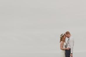 bride & groom embracing with a big open sky backdrop-black rock resort west coast wedding