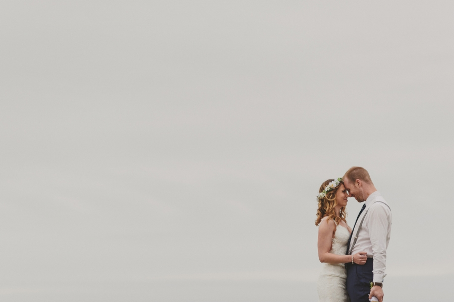 bride & groom embracing with a big open sky backdrop-black rock resort west coast wedding
