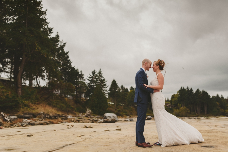 bride & groom on beach at seabreeze lodge for hornby island wedding