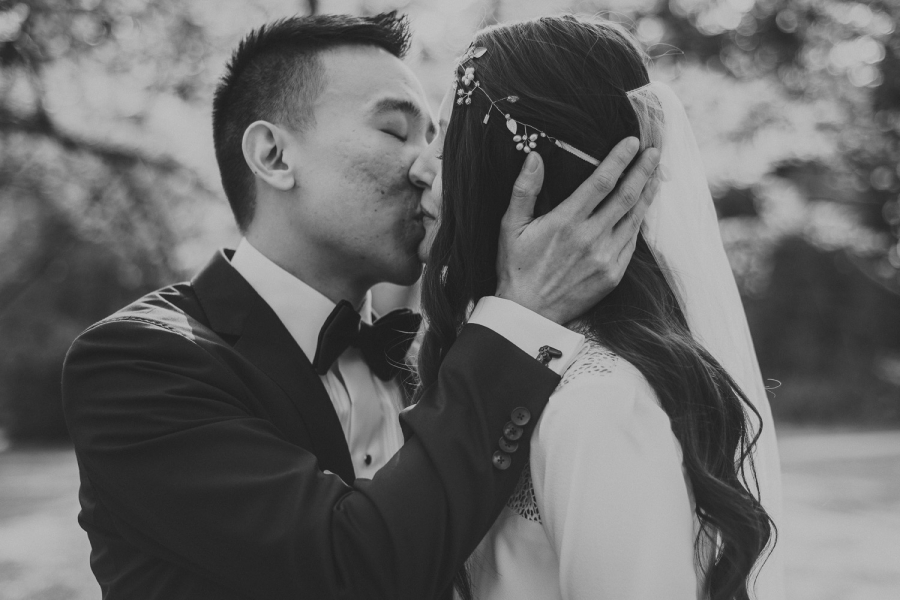 bride & groom gently kissing in stanley park - intimate downtown vancouver wedding