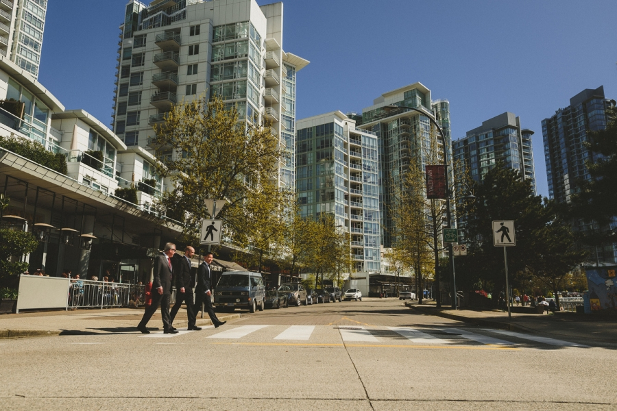 groom & groomsmen walking across a crosswalk in yaletown, vancouver, bc