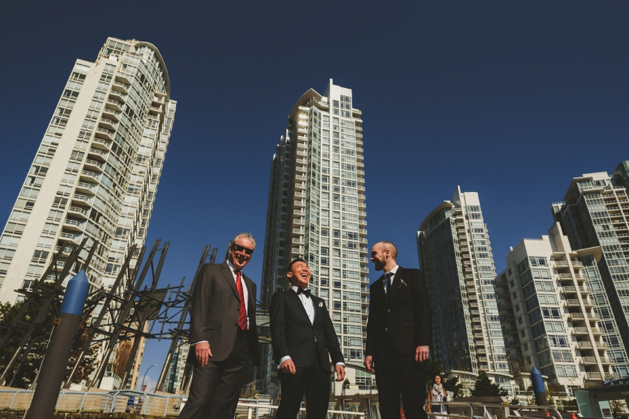 groom & 2 groomsmen in yaletown, vancouver, bc with highrises behind them