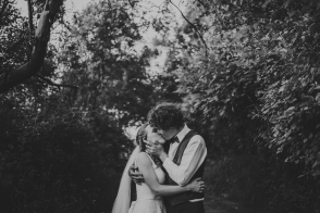 intimate moment of bride & groom kissing