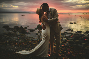 bride & groom kissing on the beach at sunset - hornby island wedding