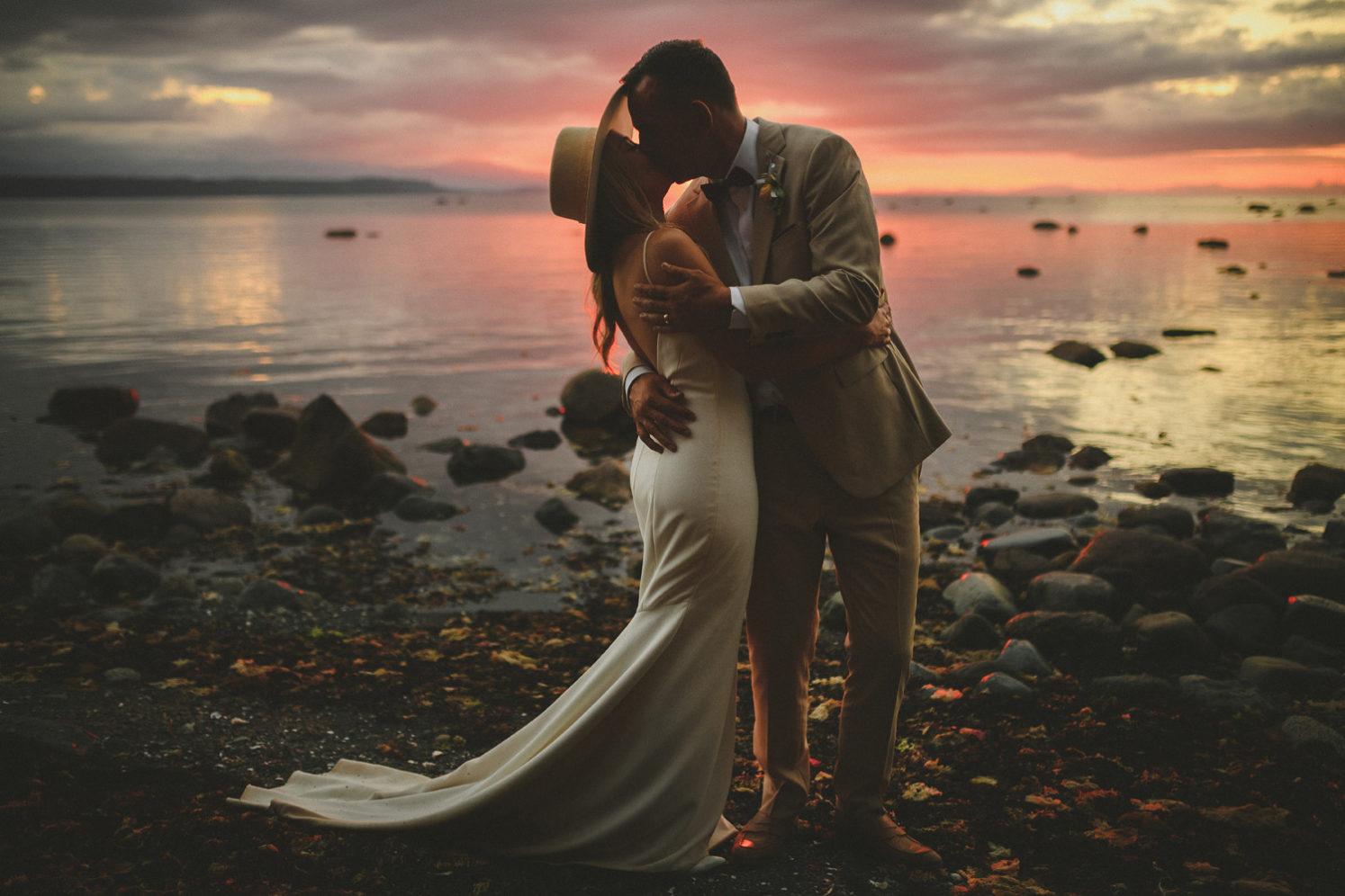 bride & groom kissing on the beach at sunset - hornby island wedding