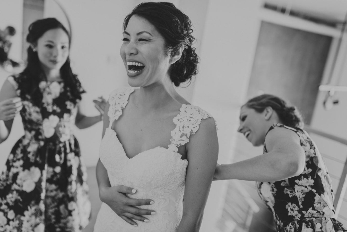 beautiful asian bride laughing with getting ready