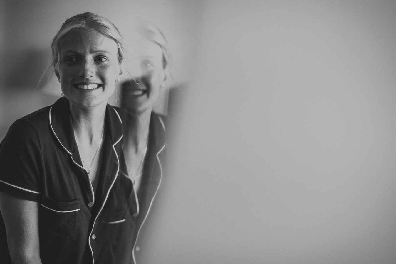 double reflection of woman in a mirror smiling