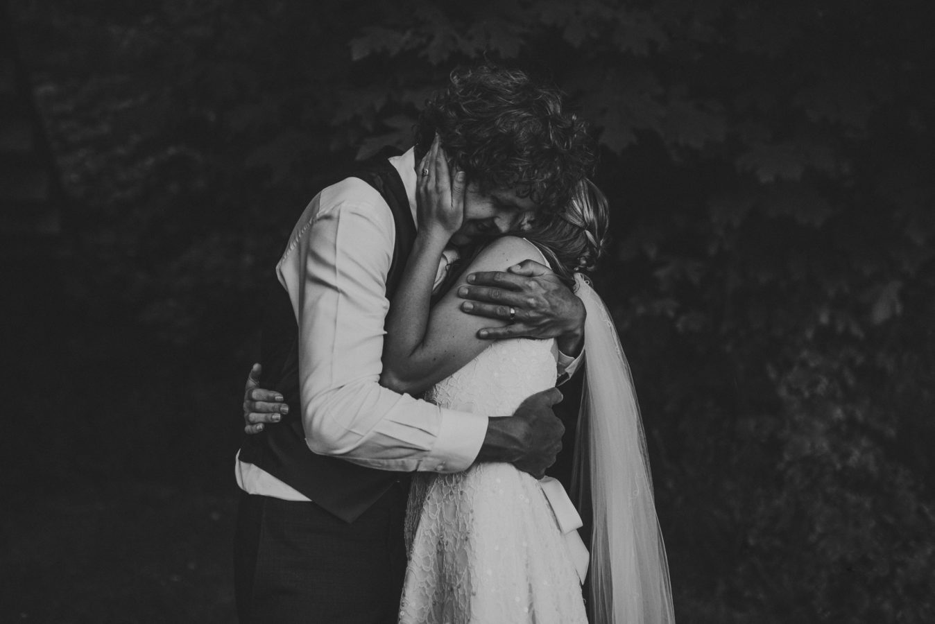 bride and groom hugging tightly on their wedding day