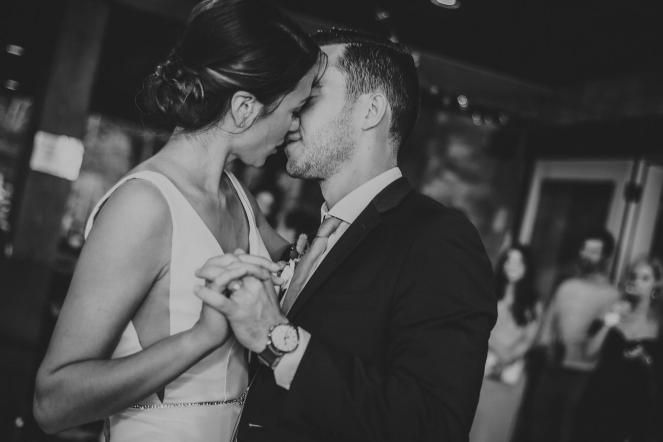 intimate moment of bride and groom kissing during their first dance