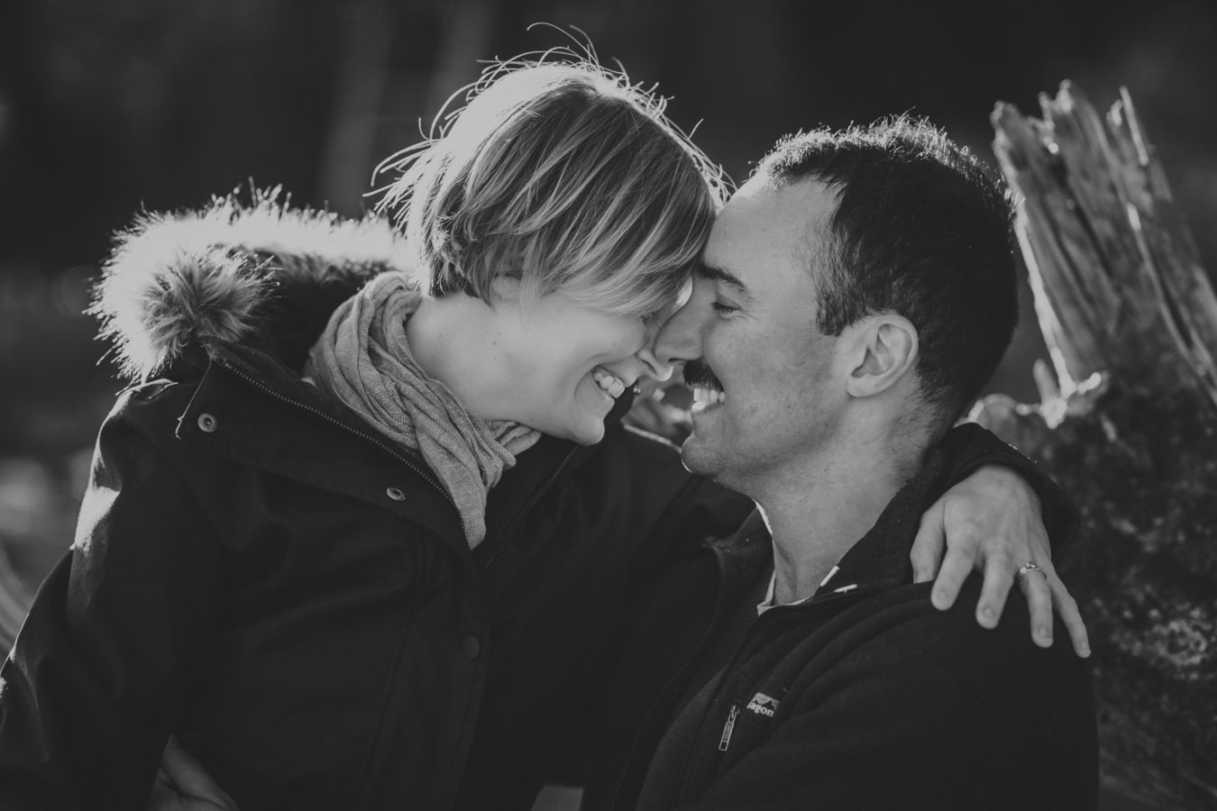 close up of a man and woman laughing with their foreheads together
